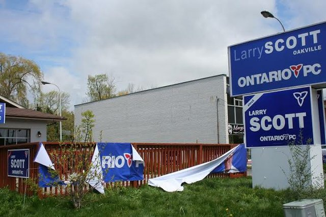 Damaged signage at headquarters of PC Candidate Larry Scott in Bronte