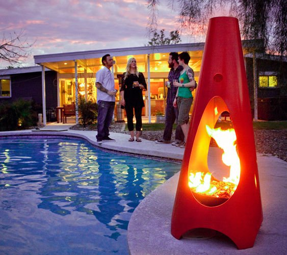 Chiminea lit by a pool