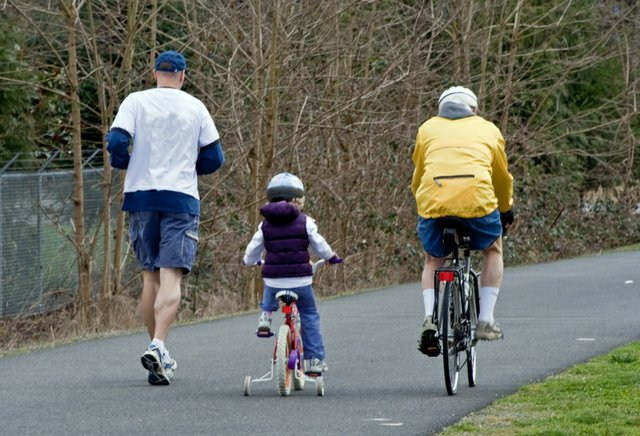 bicycle-jogger-with-child-ride-along-the-bike