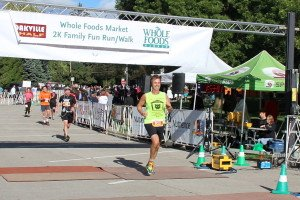 Andrew Shannon who raised $6200 of the OMHS at the finish line of the Oakville Half-Marathon